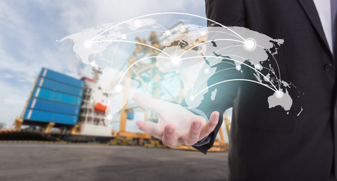 Global network coverage world map on hand of businessman ,Industrial Container Cargo freight ship at habor for Logistic Import Export background (Elements of this image furnished by NASA)